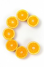 orange halves arranged in a letter C